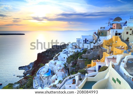Golden light on the sea and Santorini island at sunset, Greece - stock photo