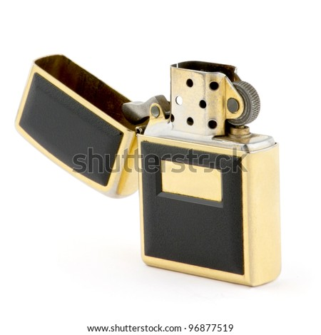 Golden lighter from steel  isolated on white - stock photo
