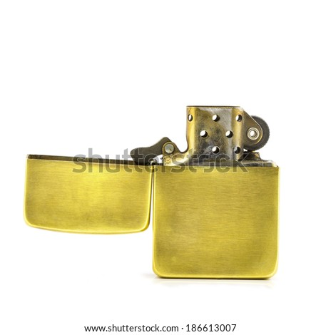 Golden lighter open on a white background isolated - stock photo