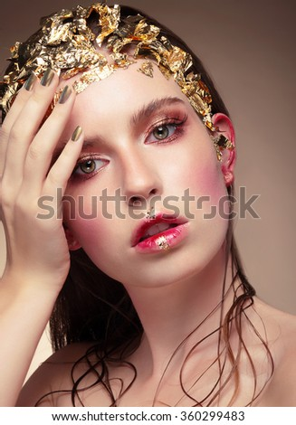 Golden Makeup.Luxury Fashion Girl Portrait. - stock photo