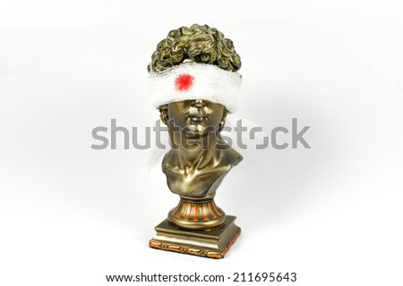 Golden Male Statuettes with white gauze of bloodied - stock photo