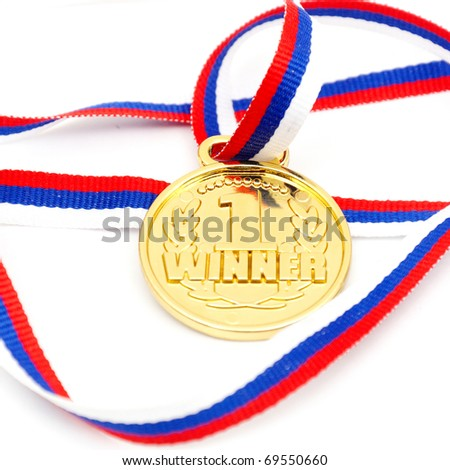 Golden medal and ribbon isolated on white background - stock photo