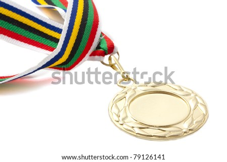 Golden medal on colorful ribbon over white - stock photo