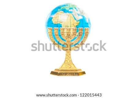 Golden Menorah and small globe in shallow DOF isolated on white background - stock photo