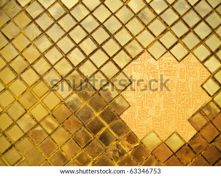 Golden mosaic wall  with chinese letters in open area - stock photo