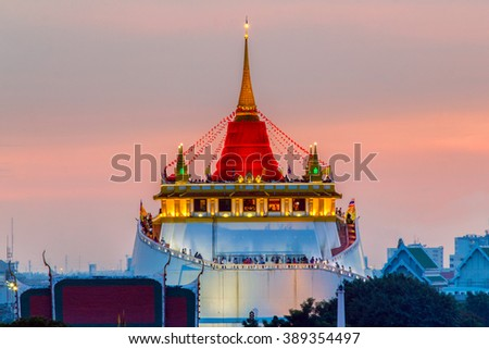 Golden Mount Temple Fair, Golden Mount Temple with red cloth in Bangkok at dusk (Wat Sraket, Thailand) - stock photo