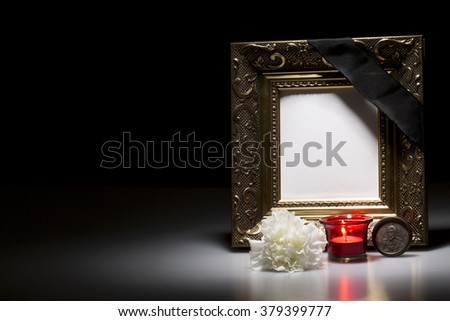 golden mourning frame with flower and candle on dark background - stock photo