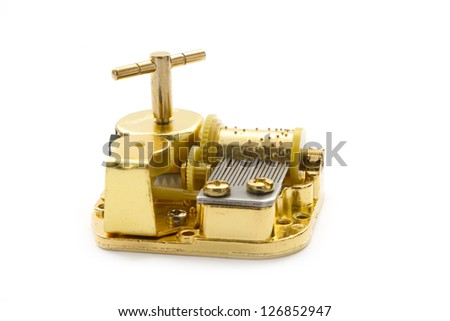 golden music toy isolated on white background - stock photo