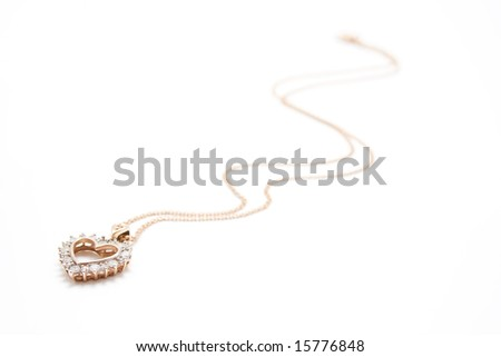 Golden necklace looks like heart - stock photo