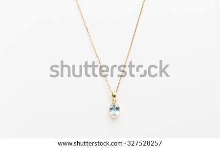 Golden necklace with pendant isolated on the white background - stock photo