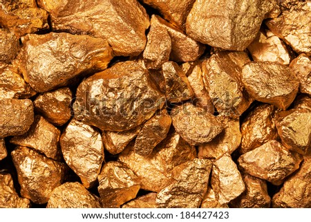 Golden nuggets closeup. Background textured. - stock photo
