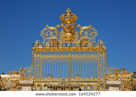 Golden Ornate Gate of Palace of Versailles With Blue Sky - stock photo