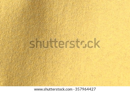 Golden paper surface as background - stock photo
