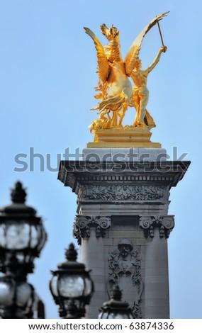 Golden Pegasus on the top of the column of the bridge Alexander III - stock photo