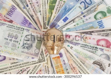 Golden piggy bank with International currencies  - stock photo
