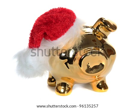 golden piggy bank with red jelly bag cap - stock photo