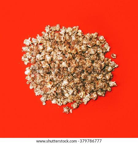 Golden Popcorn on Red Background. Minimalism style - stock photo