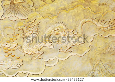 golden relief of Chinese dragon - stock photo