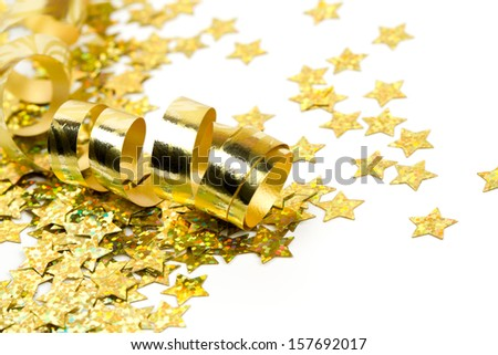 golden ribbon and confetti stars - stock photo