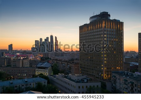 Golden ring hotel and skyscrapers in evening during sunset in Moscow, Russia - stock photo