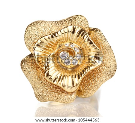 Golden ring with gold flower and clear crystals isolated on white - stock photo