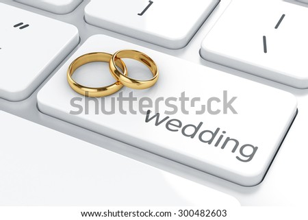 Golden rings on the computer keyboard. Wedding concept - stock photo