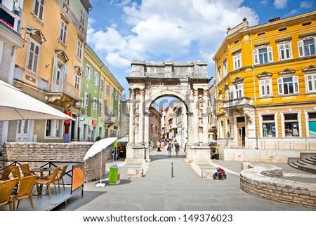 Golden Roman Gate (Sergius Arch) in Pula at sunhy day, Croatia - stock photo