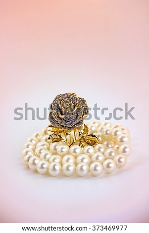 Golden rose brooch with pearls. - stock photo
