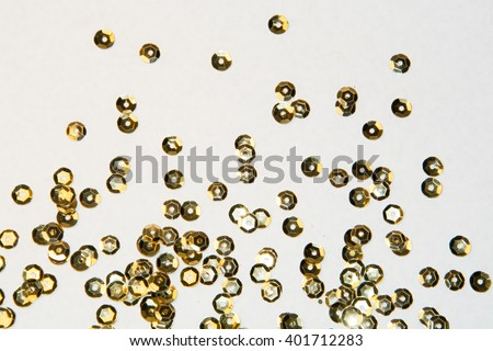 golden round sequins sewing on a white background - stock photo