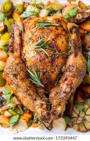 Golden Rustic Roast Chicken with Vegetables - stock photo