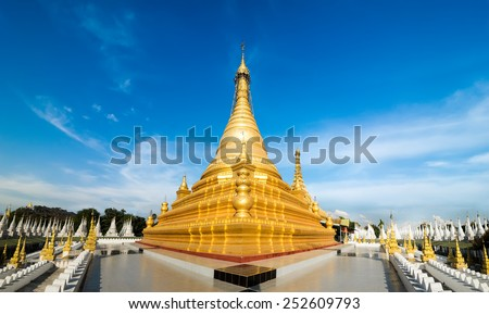 Golden Sandamuni Pagoda with row of white pagodas. Amazing architecture of Buddhist Temples at Mandalay. Myanmar (Burma) travel landscapes and destinations. Three images panorama - stock photo