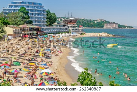 GOLDEN SANDS, BULGARIA  - JULY 06, 2013: A crowded beach scene at the Golden Sands coastal resort in Bulgaria  - stock photo