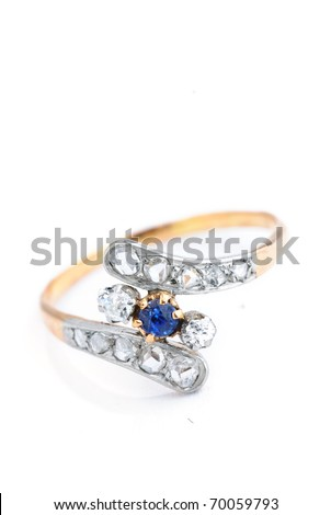 golden sapphire ring with diamonds isolated against a white background - stock photo