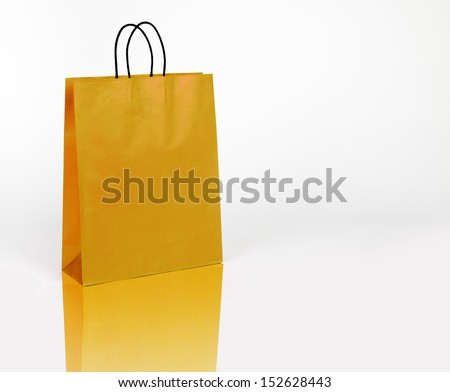 Golden shopping bag on white with space for your logo or text - stock photo