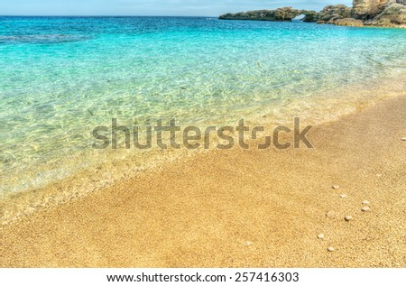 Golden shore in Cala Biriola, Sardinia. Processed for hdr tone mapping effect - stock photo