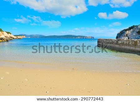 golden shore under a cloudy sky in Sardinia, Italy - stock photo