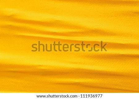 Golden silk cloth texture with wrinkle - stock photo