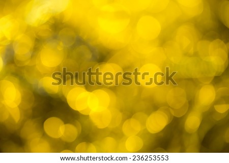Golden special occasions background. Abstract with bright twinkles, sparkles, blurred, defocused light. - stock photo
