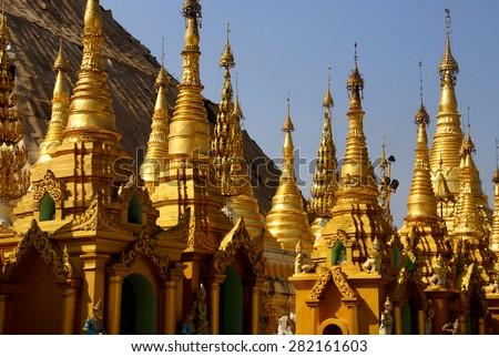 Golden spires of stupas surrounding the Shwedagon Pagoda Yangon (Rangoon),  Myanmar (Burma) - stock photo
