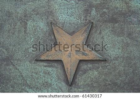 Golden star in bronze - stock photo