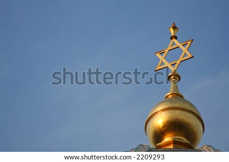 golden star of david on a blue sky in berlin, germany - stock photo