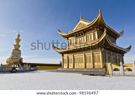 Golden statue and temple in the top of the hill - stock photo
