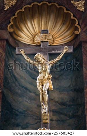 Golden Statue of Jesus Christ crucified on a cross in a church, Wroclaw, Poland - stock photo