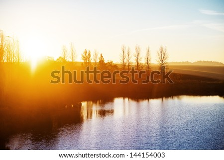 golden sunrise at lake - stock photo