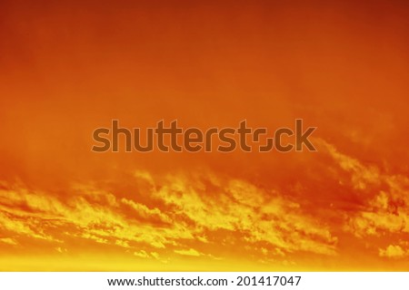 Golden sunrise / sunset with clouds - stock photo