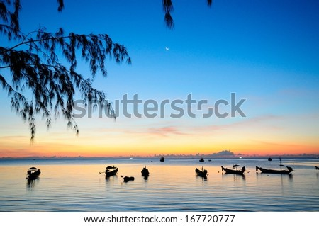 Golden sunset on a sea with silhouette of ships at Koh-Tao, Thailand - stock photo