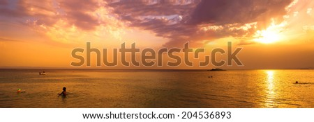 Golden sunset on Kalogria beach - panoramic view - stock photo