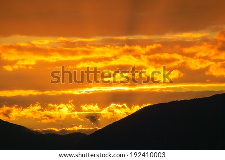 Golden sunset over a range of mountains in Stowe, Vt, USA - stock photo