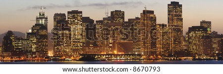Golden sunset sky behind Bay Bridge and San Francisco skyline decorated with Christmas/New Year lighting. Copy space on bottom. - stock photo