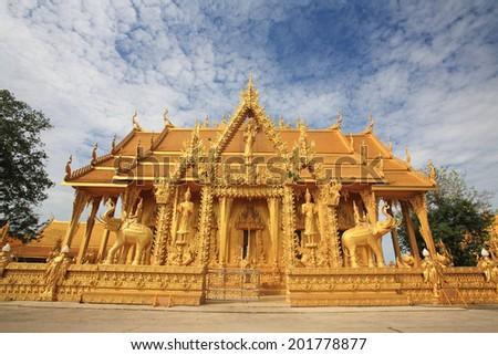 "Golden temple landmark of Wat Pak Nam ""Joe Low"" against blue sky in Chachoengsao Province, Thailand - stock photo"